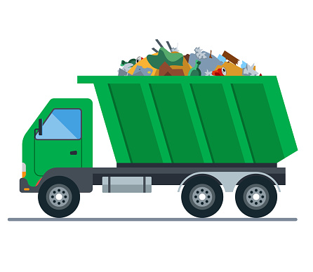 a truck loaded with garbage goes to a landfill