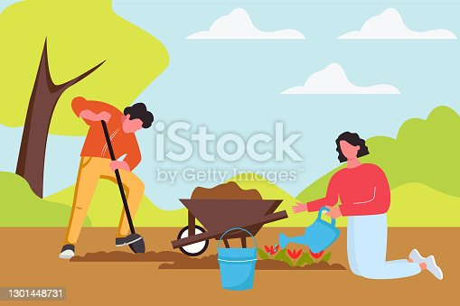 istock a woman waters and plants flowers on the land plot. The husband helps his wife plant flowers and drips earth for seedlings. The concept of a summer holiday and unity with nature 1301448731