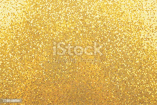 istock Abstract background texture of golden glitter 1285488881
