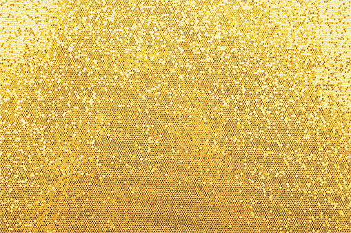 Vector illustration of abstract background texture of shiny golden glitter pattern light gradient