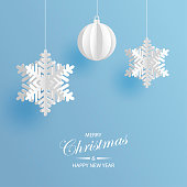 Christmas frame of decoration, fir and silver New Year ornaments. Holiday snowy background with light blue copy space.