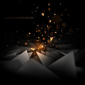 Abstract black and gold triangle shapes background with light effect in vector