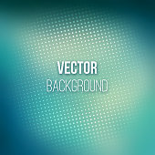 Abstract blurred background with halftone effect. Blue gradient. Dotted pattern. Shiny abstract background. Smooth blue background. Vector illustration.