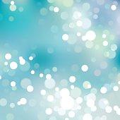 Vector illustration of blurry lights over blue background.