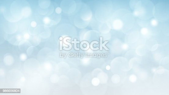 Abstract background with bokeh effects in light blue colors
