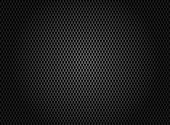 Abstract carbon fiber texture on dark background.