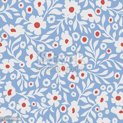 istock Abstract daisy flowers vector background. Small size meadow flowers with leaves, branches and stems. Floral deamless pattern. Flat simple decorative design. Folk art, vintage style. 1227416835