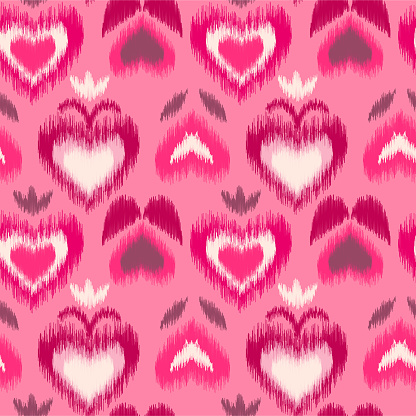 Abstract floral scribble Ikat seamless pattern with pink hearts on light pink background.
