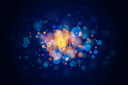 Abstract glittering bokeh circles isolated on dark background. Holiday design element.