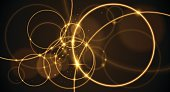 Abstract gold rings on black background in vector