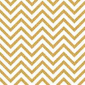 Abstract golden glitter geometric zigzag seamless pattern background.