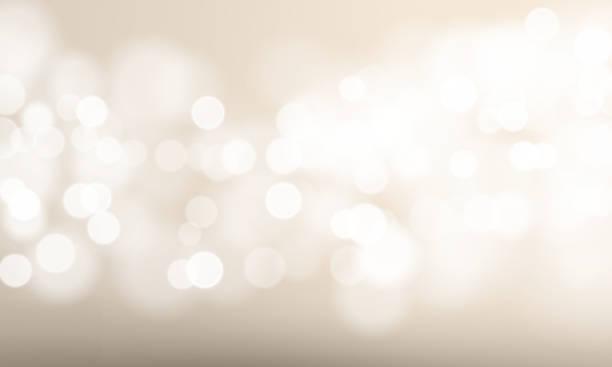 abstrakcyjne rozmycie światła i efekt bokeh tła. wektor rozmyty blask słońca lub musujące światła i błyszczący blask na festiwal lub biały szablon tła uroczystości - błyszczący stock illustrations