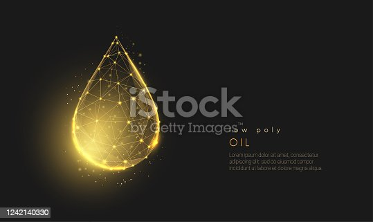 istock Abstract low poly falling golden oil drop. 1242140330