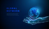 istock Abstract low poly hand holding planet Earth. 1248309107