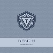 Vector illustration of Abstract Monogram graceful template. Seamless pattern background. Calligraphic elegant logo design. Letter emblem sign T. Fashion universal decorative label.