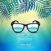 Abstract of summer time background with sunglasses and leaves of nature, sunshine bright on center of blue sky theme.