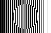 Abstract op art background made from black and white lines causing a circle shape illusion.