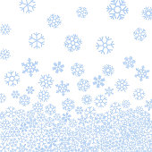 Abstract pattern of blue falling snowflakes.