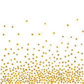 Abstract pattern of random falling golden dots.