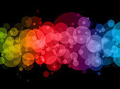 Abstract rainbow blurry dots on black background