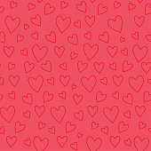 Abstract seamless pattern with red hearts on pink background