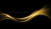 Abstract shiny color gold wave design element with glitter effect on dark background. Fashion sequins for voucher, website and advertising design