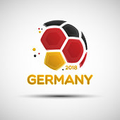 Abstract soccer ball with German national flag colors