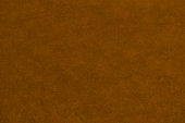 istock Abstract textured brown coloured background 1249553622