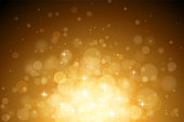 Abstract vector gold bokeh background. The eps file is organised into layers for the background, the bokeh, and the lights.