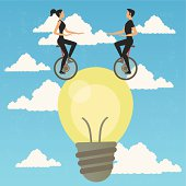 Acrobats in monocycle over an idea