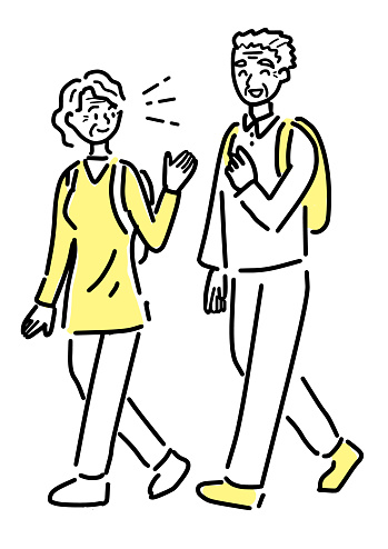 Active senior couple taking a walk with rucksack