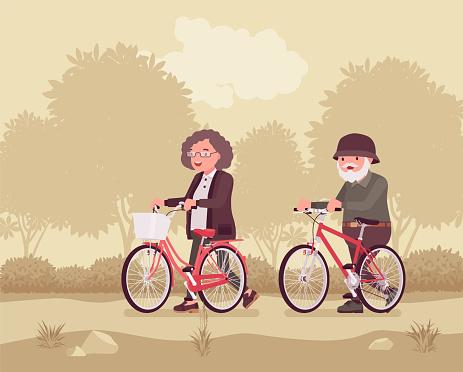 Active seniors, happy healthy elderly people enjoy sport, riding bicycle