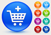 Add to Shopping Cart Icon on Shiny Color Circle Buttons. The icon is positioned on a large blue round button. The button is shiny and has a slight glow and shadow. There are 8 alternate color smaller buttons on the right side of the image. These buttons feature the same vector icon as the large button. The colors include orange, red, purple, maroon, green, and indigo variations.