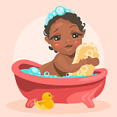Adorable, cute baby in the bathtub with bubbles