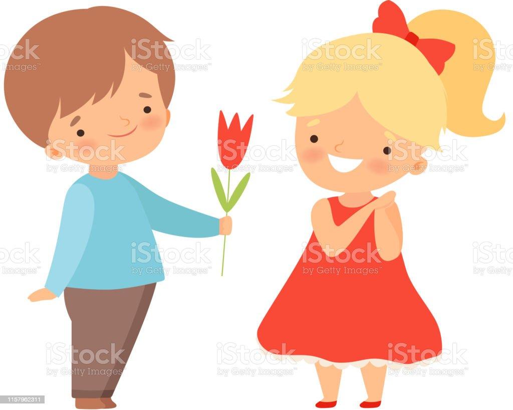 Petit Garçon Adorable Donnant La Fleur Rouge De Tulipe à La
