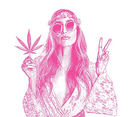 Adult hippie woman holding cannabis leaf