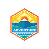 Adventure outdoor travel - concept business badge sign vector illustration. Mountains nature creative sign emblem in hexagon shape. Lake water waves, sunrise. Graphic design element.