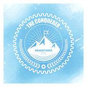 Vector adventurer badge design over watercolor background.