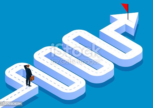istock Adversity, businessman standing at a rugged intersection looking at the flag at the end 1226909094