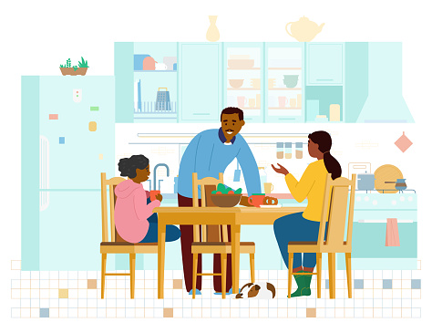 African American Family Spending Time Together In The Kitchen