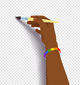 African american hand drawing with paintbrush