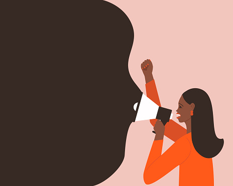 African American woman makes an announcement in a megaphone