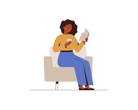African American woman reads the book in office or home.