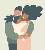 African American young parents hugging their daughter stylish earthy colors portrait.