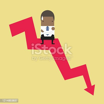 African businessman sitting on graph down.