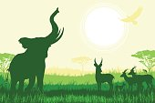 African Safari background with trumpeting elephant and antelopes