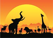 African safari silhouetes in black with a large sun setting. A collection of animals in silhouette on the horizon include an elephant, giraffe, gazelle, lion, monkey, ostrich, flamingo and wildebeest.