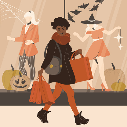 African woman is shopping before Halloween