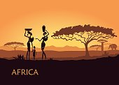 African woman on sunset background