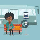 African-american business woman with a briefcase waiting for a bus at the bus stop. Young smiling business woman sitting on the bus stop bench. Vector cartoon illustration. Square layout.